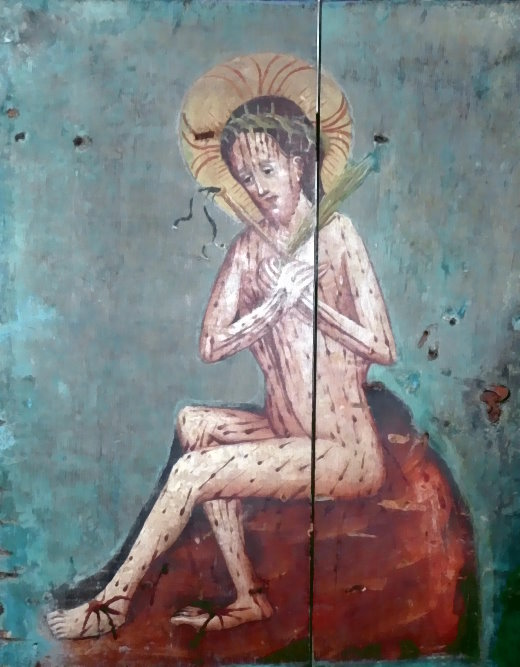 Gemälde des gekreuzigten Christus auf der Innenseite der oberen eisenbeschlagenen Tür des Sakraments-Schrankes in der St. Clemens Kirche auf der nordfriesischen Insel Amrum!